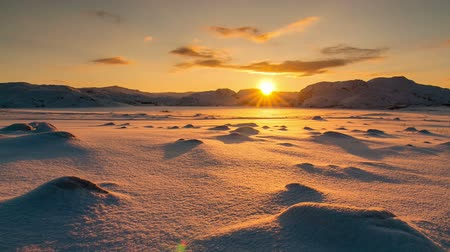 chukchi : Snowy Arctic tundra at sunset. Timelapse