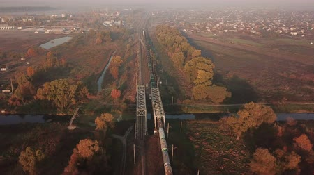 Cargo train at sunrise in the fog. View from the drone Vídeos