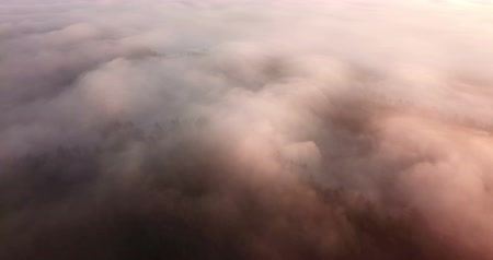 Beautiful misty dawn. Flying above the clouds, drone video Vídeos