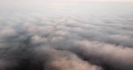 Beautiful misty dawn. Flying above the clouds, drone video Стоковые видеозаписи
