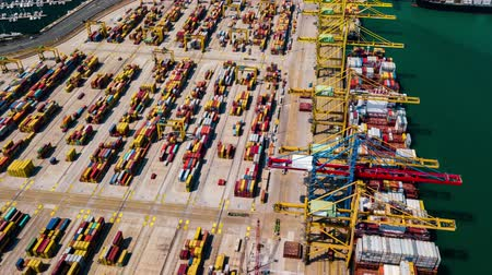 area of port : Industrial Cargo area with container ship in dock at port, Aerial view Stock Footage