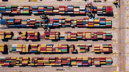 unload : Industrial Cargo area with container ship in dock at port, Aerial view Stock Footage