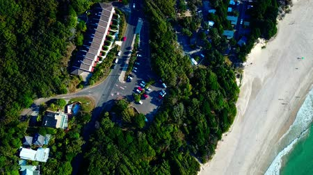 Австралия : Parking in a small town. Forest. Beach. Aerial top view