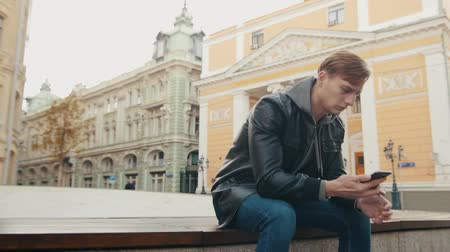 korhadt : Young brutal man calls in a beautiful European city. Slo-mo