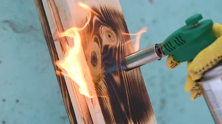 laboring : Fire flame concept Burning wood burner burns wood planking fire flames wood texture worker at constructing tool concept Stock Footage