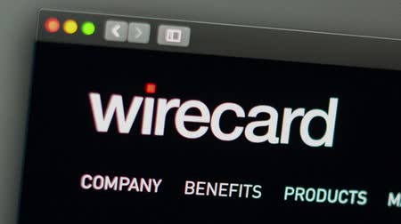 эмблема : Miami  USA - 04.28.2019: Wirecard company website homepage. Close up of Wirecard logo. Can be used as a website for websites, good for info, business or marketing concept. Стоковые видеозаписи