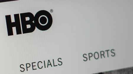 iyi olmak : Miami  USA - 04.28.2019: HBO company website homepage. Close up of HBO logo. Can be used as a website for websites, good for info, business or marketing concept. Stok Video