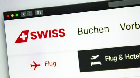 nagyító : Washington, USA - April 03, 2019: Air carrier Swiss website homepage. Swiss logo visible through a magnifying glass. ? or?