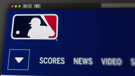 webseite : Miami  USA - 20.04.2019: Homepage der Major League Baseball-Website. Nahaufnahme des MLB-Logos. Kann als Illustration für Nachrichten- oder Marketingkonzepte verwendet werden. Videos