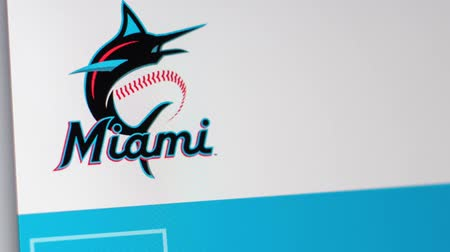 fama : Miami  USA - 04.20.2019: Baseball Team Miami Marlins website homepage. Close up of team logo. Can be used as an illustrative for news or marketing concept.