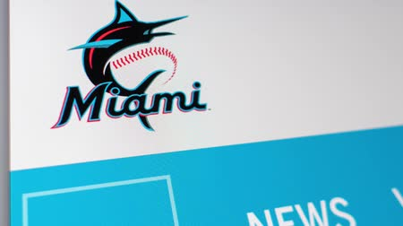 un : Miami  USA - 04.20.2019: Baseball Team Miami Marlins website homepage. Close up of team logo. Can be used as an illustrative for news or marketing concept.