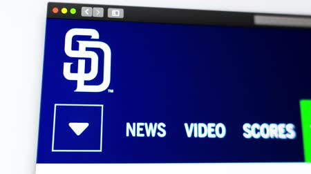 szemléltető : Miami  USA - 04.20.2019: Baseball team San Diego Padres website homepage. Close up of team logo. Can be used as an illustrative for news or marketing concept. Stock mozgókép