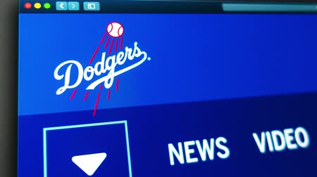 fame : Miami  USA - 04202019: Baseball team Los Angeles Dodgers website homepage. Close up of team logo. Can be used as an illustrative for news or marketing concept. Stock Footage