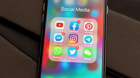apple sign : Tallinn  Estonia - September 18, 2019: Black Apple iPhone with icons of social media: instagram, youtube, pinterest, facebook, twitter, telegram application on screen. Social media icons.