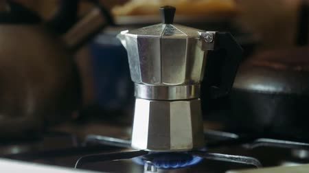Moka pot brewing on a gas stove. Taditional way of brewing Italian coffee. Stock Footage