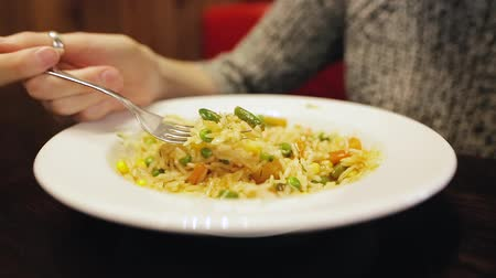 brown rice : Pretty european woman eating hot rice in Thai sitting in a cafe. Stock Footage
