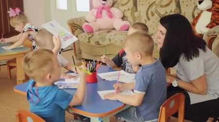 orphans : SUMY, UKRAINE - JUN 24, 2017: Drawing orphans in an orphanage.