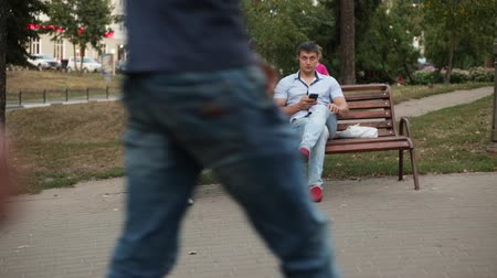 SUMY, UKRAINE - AUG 31, 2018: Young modern family uses their smartphones instead of communicating. Stock mozgókép