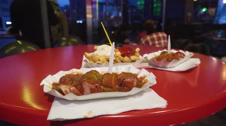 speciality : BERLIN, GERMANY - NOV 24, 2018: Traditional German currywurst, served with french fries. Stock Footage