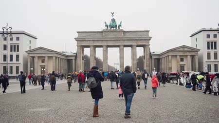 BERLIN, GERMANY - NOV 24, 2018: Tourists crowd walk on square near Brandenburg Gate.