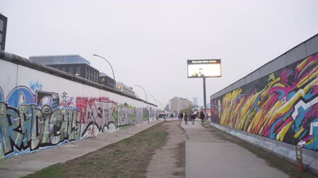 BERLIN, GERMANY - NOV 22, 2018: Pan shot of the remains of the Berlin Wall.