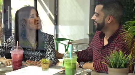man eating : Attractive young couple eating lunch together and having a good time Stock Footage