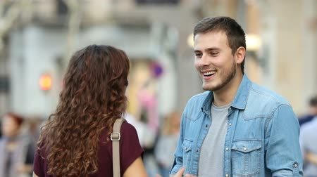 gives you : Happy man talking with a woman in the street