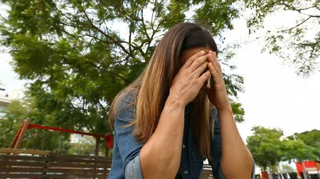 repentance : Desperate woman crying in a park Stock Footage