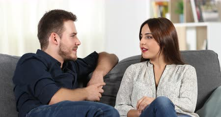 gives you : Relaxed couple sitting on couch at home Stock Footage