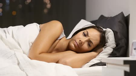 deprivation : Insomniac woman can not sleep in the bed at home in the night