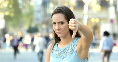 refusing : Angry woman gesturing down in the middle of the street Stock Footage