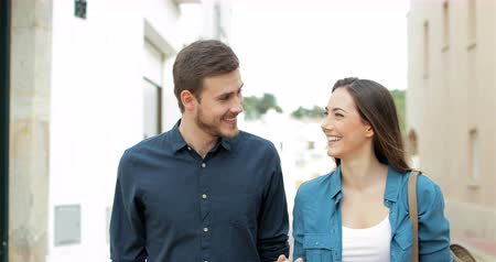 gives you : Happy couple or friends talking walking towards camera in the street Stock Footage