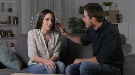 stres : Stressed woman saying no and man insisting on the first date in the night at home