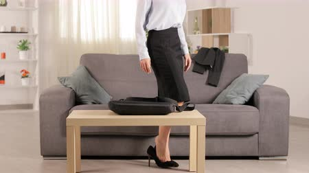 alma : Tired businesswoman arriving home and resting lying on couch at home