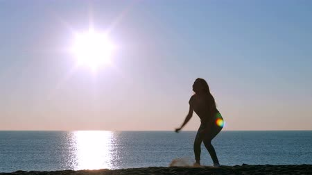 eufória : Full body portrait of a happy single excited girl jumping on the beach at sunrise