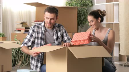 belongings : Happy couple moving home on the floor