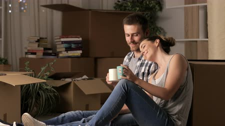 Couple relaxing home on the floor at home