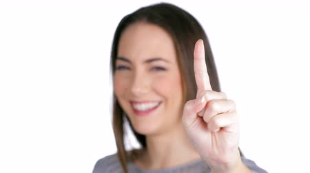 forefinger : Happy woman gesturing with finger isolated on white background Stock Footage