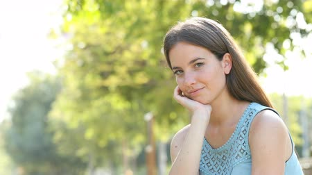 esteem : Portrait of a serious woman looking at camera in a park Stock Footage