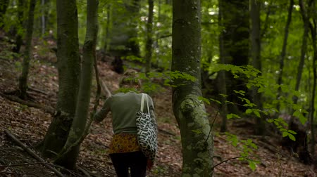 классный : Young Woman is walking in Forest Background