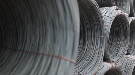 přadeno : rolls of barbed wire . wound wire at the factory. Iron proloco wound into large coils and are a bunch .