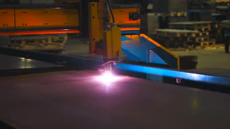 welding torch : plasma cutter cuts metal. plasma machine for cutting metal. welding. cutting robot