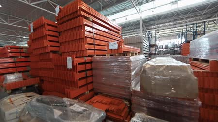 aluminium : Warehouse of metal profiles . The orange profile to create the warehouse. metal pipe