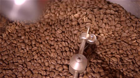 roaster : Coffee roaster .VAT for roasting coffee beans. roaster. Coffee beans in the grinder. Fresh Coffee In coffee professional machine. Aroma.