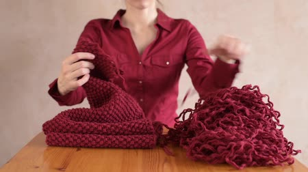 undo : Woman unravelling the red scarf
