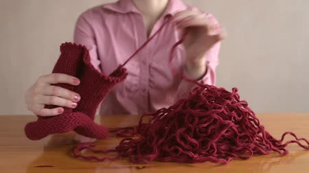 undo : Woman in pink unravelling the knitting Stock Footage