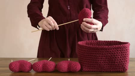 crochê : Woman and crocheted hearts Stock Footage