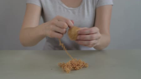 meada : Woman making a ball from yellow yarn