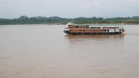 saen : Chiang Rai. Thailand - Octuber 25, 2017: Tourists on the boat sail along the Mekong River In Golden Triangle at Chiangsan, Chiang Rai, Thailand.