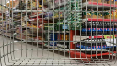 shopping cart in supermarket moving through, time lapse Stock Footage